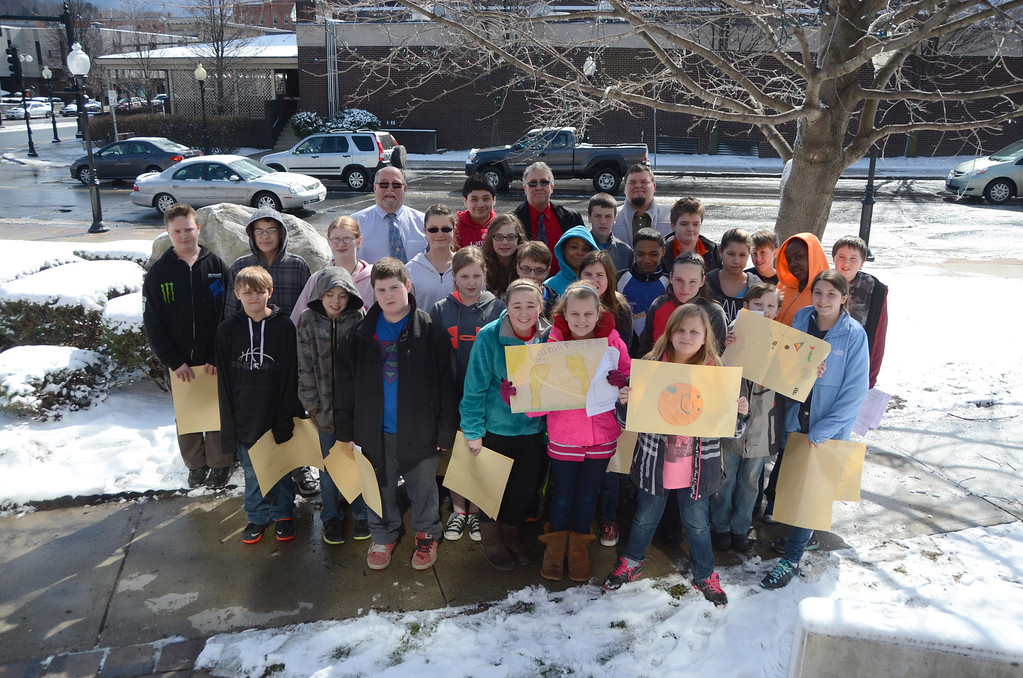 Description of . Sullivan School students in Jim Holmes' sixth grade class met with Mayor Richard Alcombright, to give him a Earth Day poster, one of a dozen they made, and then continued on giving them to local businesses to display in their storefronts in downtown North Adams on Wednesday, April, 16, 2014. Students pose with their posters and the Mayor in front of City Hall. Gillian Jones / Berkshire Eagle Staff / photos.berkshireeagle.com