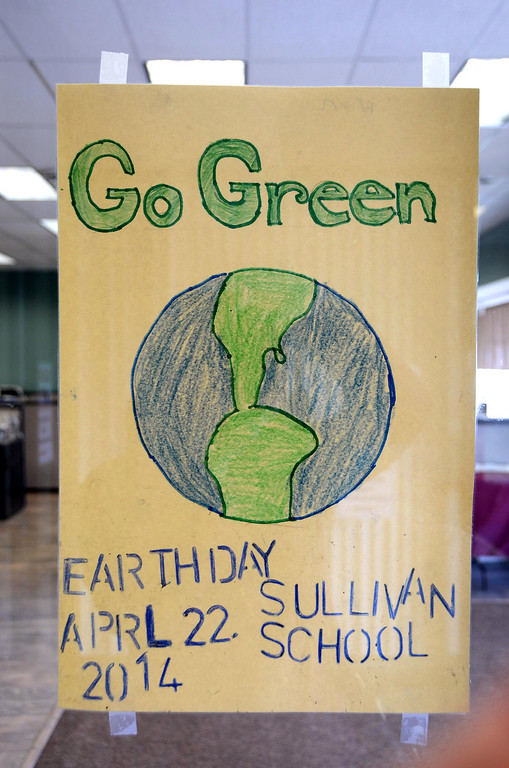 Description of . One of the Earth Day posters made by a sixth grader in Jim Holmes' s class at Sullivan School hangs in the window of the Berkshire Eagle and other storefronts in downtown North Adams on Wednesday, April, 16, 2014. Gillian Jones / Berkshire Eagle Staff / photos.berkshireeagle.com