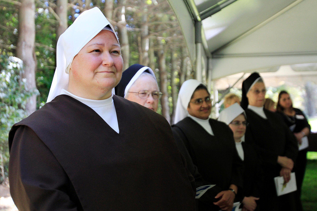 Description of . Carmelite nuns attend a press conference announcing the sale of the Providence Care Center from the Sisters of Providence Health System to the Carmelite Sisters at the facility in Lenox. Monday, September 30, 2013. Stephanie Zollshan/Berkshire Eagle Staff.