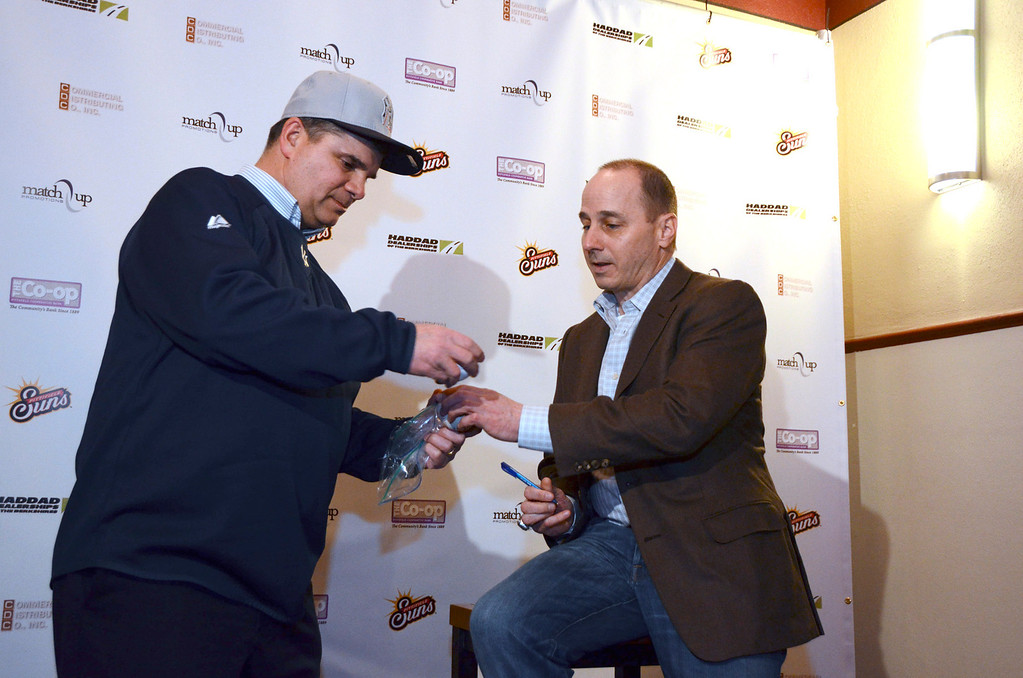 Description of . Yankees Fan Michael Burton of Pittsfield has two baseballs signed by New York Yankees General Manager Brian Cashman during a meet and greet and The Colonial Theater in Pittsfield on Thursday, Jan. 30, 2014. Gillian Jones/Berkshire Eagle Staff