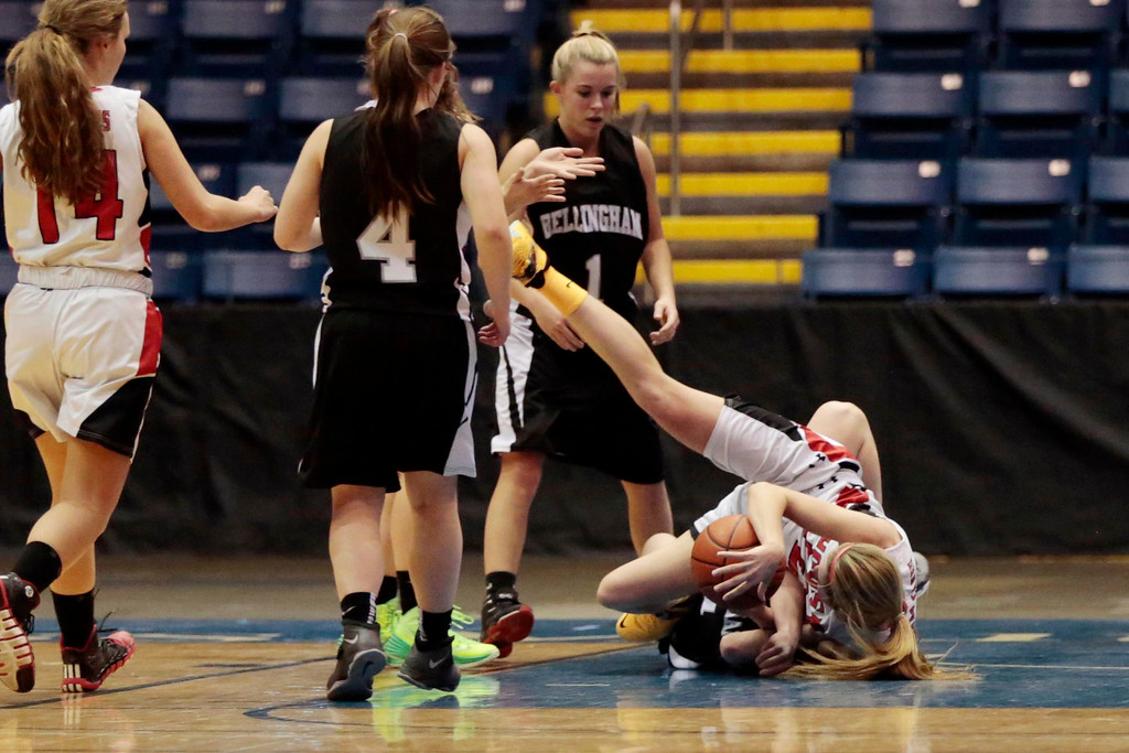 Description of . Hoosac's Megan Rodowicz struggles with her opponent for the ball on the floor in the state semifinal basketball game that they won against Bellingham at the MassMutual Center in Springfield. Tuesday, March 11, 2014. Stephanie Zollshan / Berkshire Eagle Staff / photos.berkshireeeagle.com