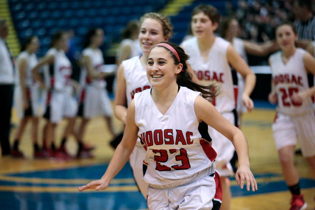 Description of . Hoosac's Mckenzie Robinson and the rest of her team run to their coaches after winning the state semifinal basketball game against Bellingham at the MassMutual Center in Springfield. Tuesday, March 11, 2014. Stephanie Zollshan / Berkshire Eagle Staff / photos.berkshireeeagle.com