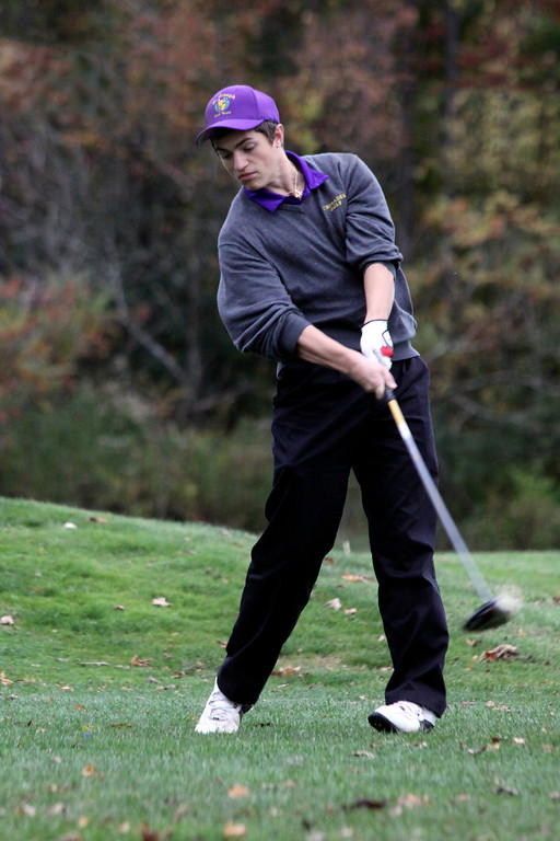 Description of . Tim Jones, of St. Joseph's High School, takes a swing at the Pontoosuc Lake Country Club on Thursday, Oct. 10, 2013.  (Holly Pelczynski/Berkshire Eagle)