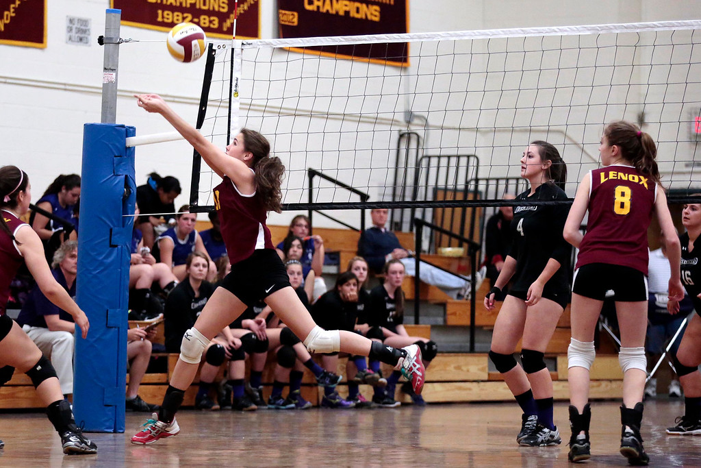 Description of . Lenox's Sophie Silverstein jumps for the ball during a volleyball game against Pittsfield at Lenox Memorial High School. Monday, September 23, 2013. Stephanie Zollshan/Berkshire Eagle Staff.