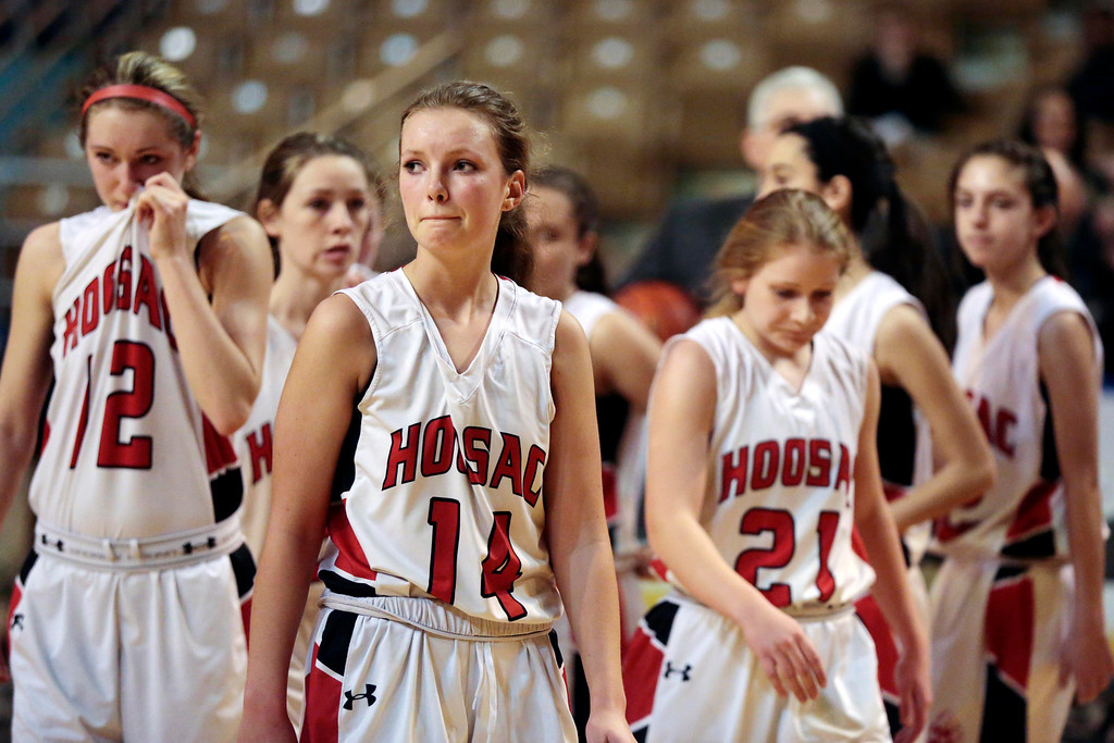 Description of . The Hoosac girls basketball team walks back to their bench dejected after being defeated by St. Mary's in the state championship game in Worcester. Saturday, March 15, 2014. Stephanie Zollshan / Berkshire Eagle Staff / photos.berkshireeagle.com
