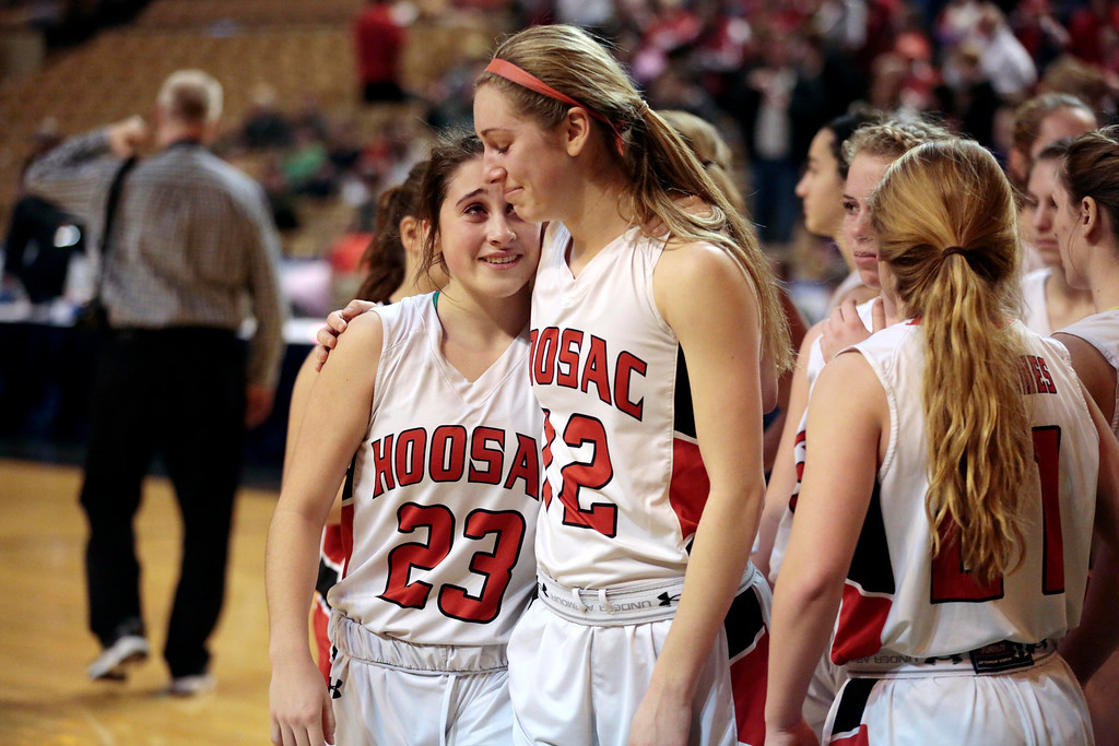 Description of . Hoosac's Mckenzie Robinson, left, and Megan Rodowicz console each other after being defeated by St. Mary's in the basketball state championship game in Worcester. Saturday, March 15, 2014. Stephanie Zollshan / Berkshire Eagle Staff / photos.berkshireeagle.com