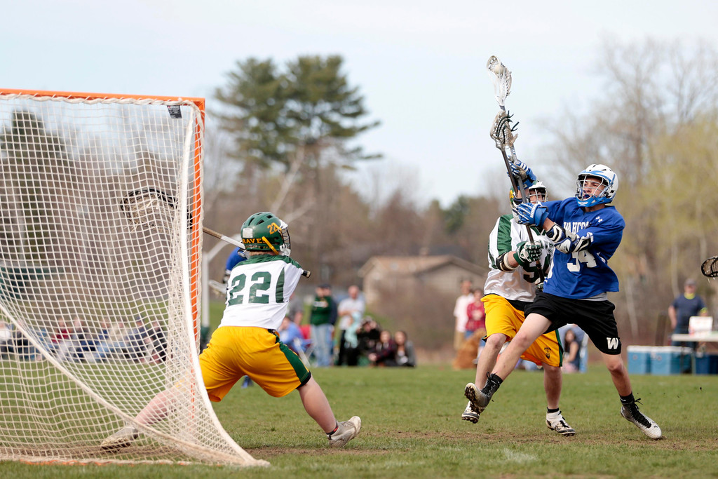 Description of . Wahconah's Curran Pularo takes a shot and scores during a lacrosse game at Taconic High School in Pittsfield. Wednesday, May 7, 2014. Stephanie Zollshan / Berkshire Eagle Staff / photos.berkshireeagle.com