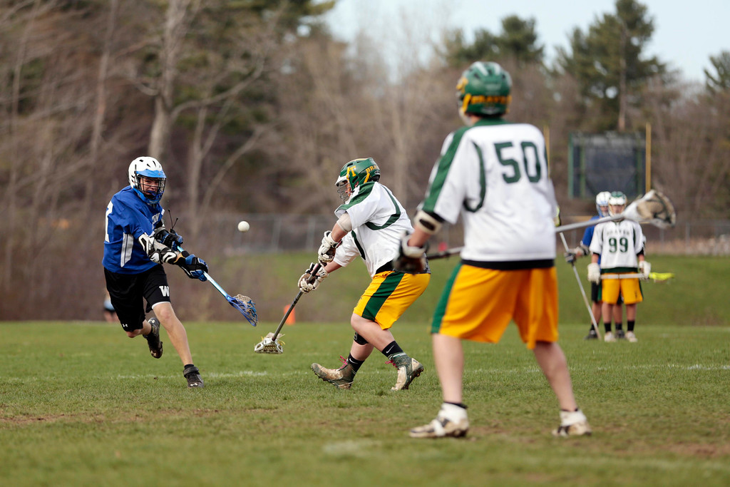 Description of . Wahconah's Nick Clayton takes a shot and scores during a lacrosse game at Taconic High School in Pittsfield. Wednesday, May 7, 2014. Stephanie Zollshan / Berkshire Eagle Staff / photos.berkshireeagle.com