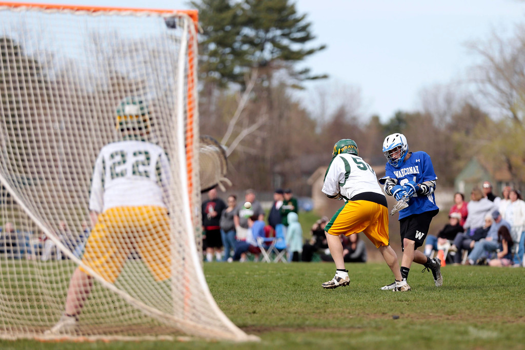 Description of . Wahconah's Curran Pularo takes a shot on goal during a lacrosse game at Taconic High School in Pittsfield. Wednesday, May 7, 2014. Stephanie Zollshan / Berkshire Eagle Staff / photos.berkshireeagle.com