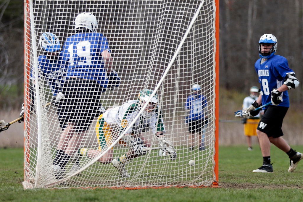 Description of . Despite falling, Taconic's Mike Perkett scores a goal during a lacrosse game against Wahconah at Taconic High School in Pittsfield. Wednesday, May 7, 2014. Stephanie Zollshan / Berkshire Eagle Staff / photos.berkshireeagle.com