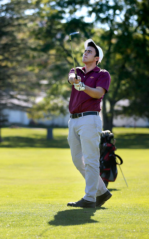 Description of . Lenox's Kris Vahle hits his ball from the fairway during a golf match against Wahconah at Wahconah Country Club in Dalton. Monday, September 30, 2013. Stephanie Zollshan/Berkshire Eagle Staff.
