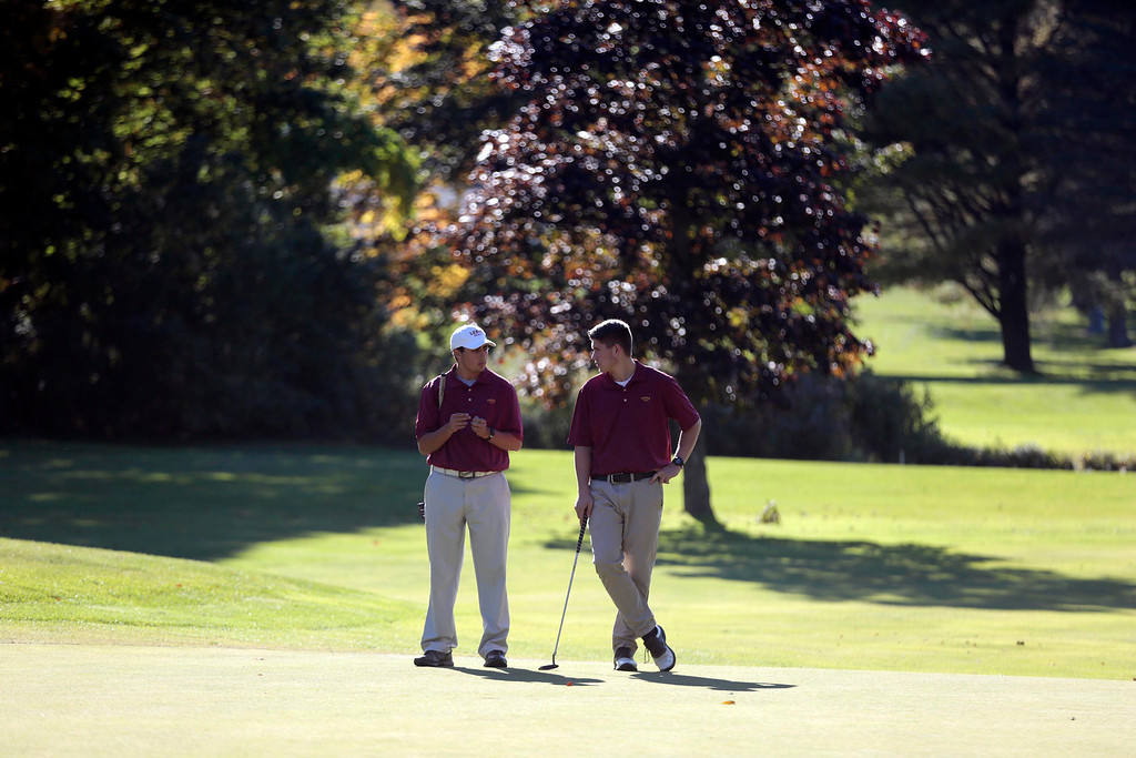 Description of . Lenox's Cameron Sibley, left, and Zach Levesque chat on the green during a golf match against Wahconah at Wahconah Country Club in Dalton. Monday, September 30, 2013. Stephanie Zollshan/Berkshire Eagle Staff.