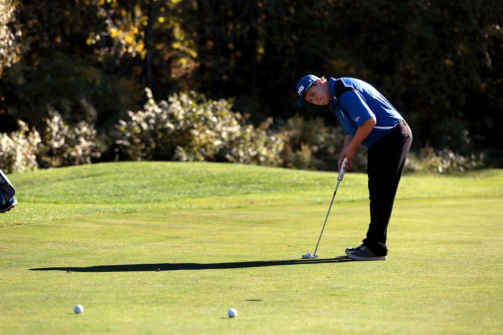 Description of . Wahconah's Tyler Garrett lines up his putt during a golf match against Lenox at Wahconah Country Club in Dalton. Monday, September 30, 2013. Stephanie Zollshan/Berkshire Eagle Staff.