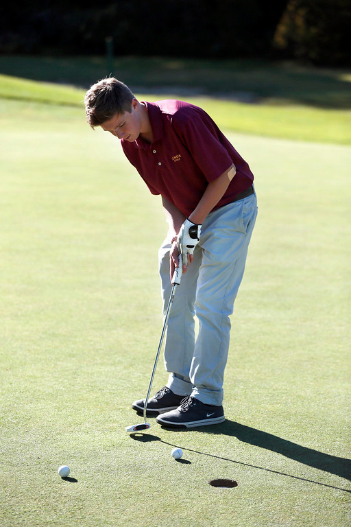 Description of . Lenox's Noah Hunter sinks his putt during a golf match against Wahconah at Wahconah Country Club in Dalton. Monday, September 30, 2013. Stephanie Zollshan/Berkshire Eagle Staff.