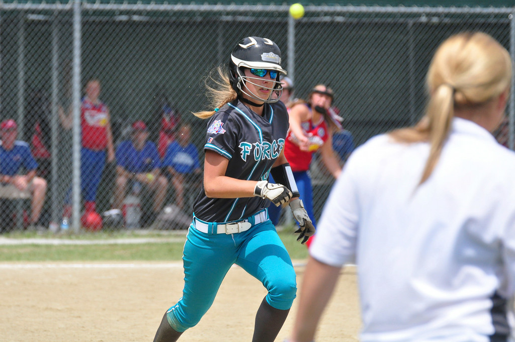 Description of . Berkshire Force's Allie Hunt runs to first base after she bunts the ball in her team's game against Rochester, on Sunday, August, 3, 2014. Gillian Jones / Berkshire Eagle Staff / photos.berkshireeagle.com