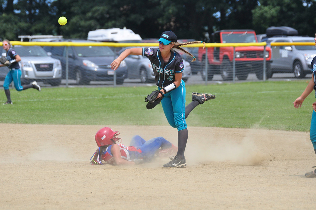 Description of . Berkshire Force's Allie Hunt throws the ball to home plate after tagging out a Rochester player at second base, on Sunday, August, 3, 2014. Gillian Jones / Berkshire Eagle Staff / photos.berkshireeagle.com
