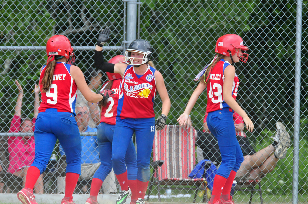 Description of . The Rochester Slammers celebrate a three run lead against Berkshire Force in the 9th inning, on Sunday, August, 3, 2014. Gillian Jones / Berkshire Eagle Staff / photos.berkshireeagle.com
