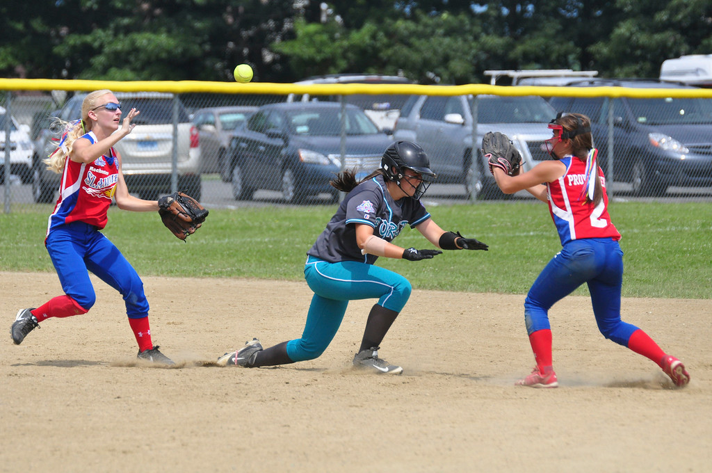Description of . Berkshire Force's Emily Koldys is caught between two Rochester players as she tries to get safely back to base, on Sunday, August, 3, 2014. She manages to make it safely back to second base. Gillian Jones / Berkshire Eagle Staff / photos.berkshireeagle.com