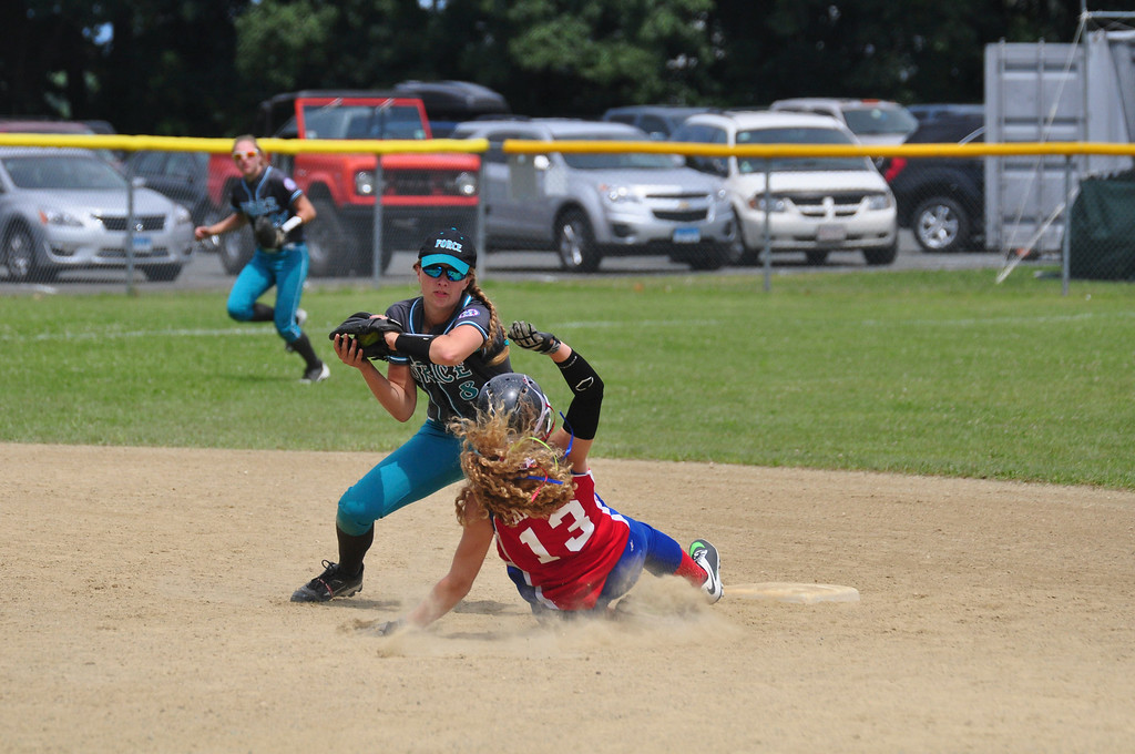 Description of . Berkshire Force's Allie Hunt tags out a Rochester player at second base, on Sunday, August, 3, 2014. Gillian Jones / Berkshire Eagle Staff / photos.berkshireeagle.com