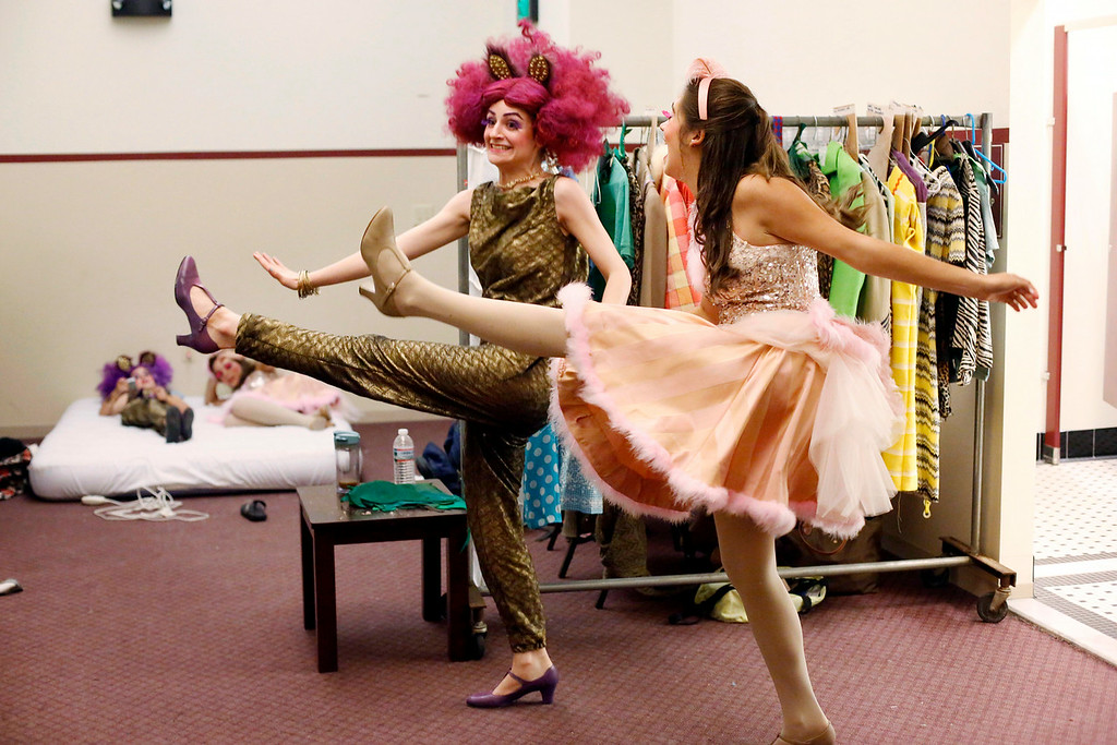 Description of . Caroline Fairweather, left, and Hanna Koczela let off some steam with a bit of line dancing in the dressing room during intermission in the final dress rehearsal for Berkshire Theatre Group's performance of 'Seussical' at the Colonial Theatre in Pittsfield. Wednesday, August 6, 2014. Stephanie Zollshan / Berkshire Eagle Staff / photos.berkshireeagle.com