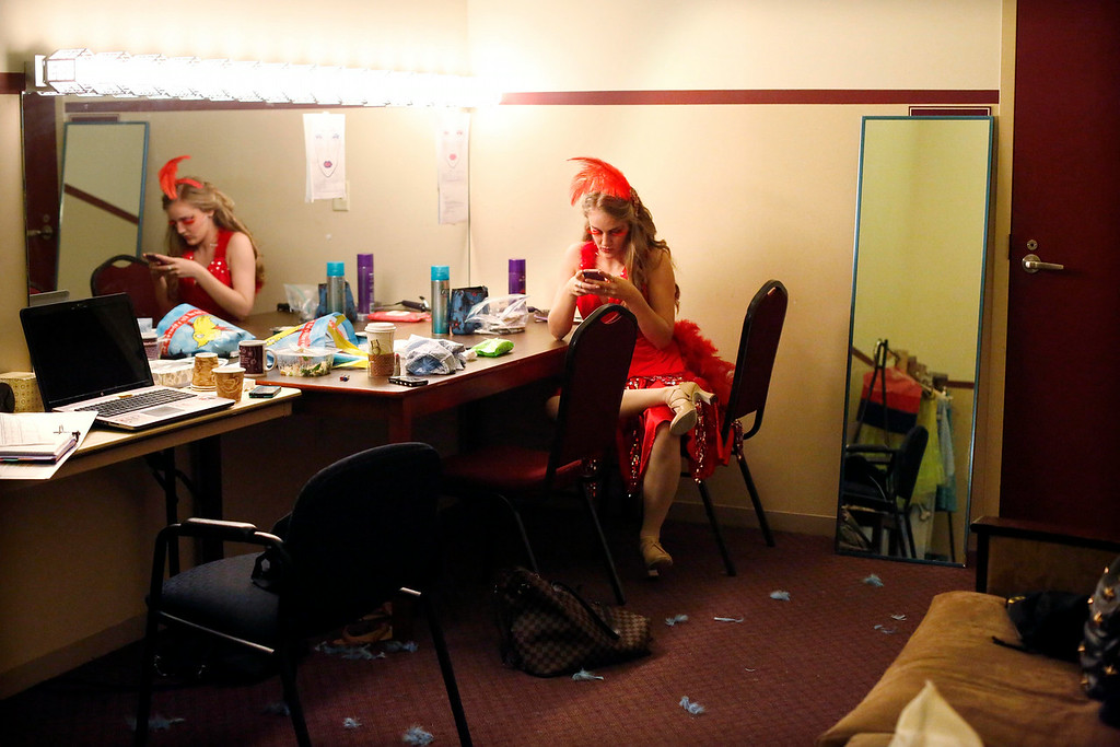 Description of . Allie Seibold, who plays Mayzie La Bird, checks her phone in her dressing room during intermission in the final dress rehearsal for Berkshire Theatre Group's performance of 'Seussical' at the Colonial Theatre in Pittsfield. Wednesday, August 6, 2014. Stephanie Zollshan / Berkshire Eagle Staff / photos.berkshireeagle.com
