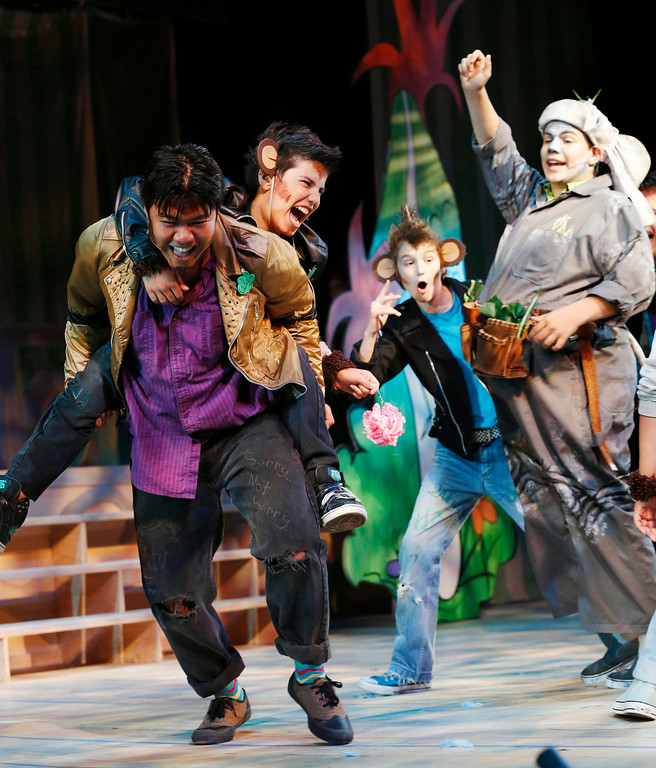 Description of . The Wickersham Brothers, a group of troublesome monkeys, steal from Horton the elephant during a scene in the final dress rehearsal for Berkshire Theatre Group's performance of 'Seussical' at the Colonial Theatre in Pittsfield. Wednesday, August 6, 2014. Stephanie Zollshan / Berkshire Eagle Staff / photos.berkshireeagle.com