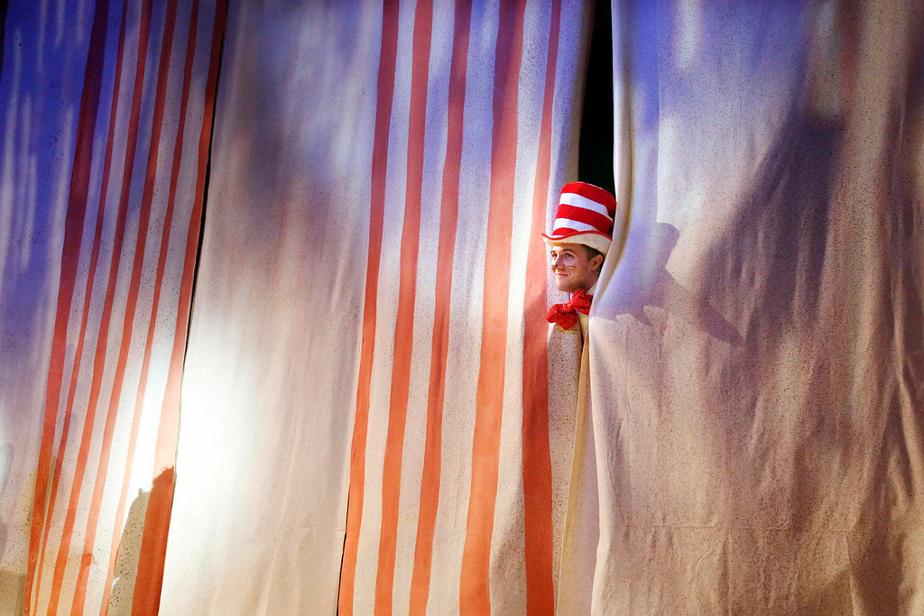 Description of . The Cat in the Hat, played by Cody Lee Miller, pops out from the curtain during the final dress rehearsal for Berkshire Theatre Group's performance of 'Seussical' at the Colonial Theatre in Pittsfield. Wednesday, August 6, 2014. Stephanie Zollshan / Berkshire Eagle Staff / photos.berkshireeagle.com