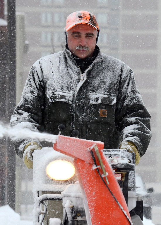 Description of . Don Scace is covered in snow as he cleans the sidewalk at Berkshire Bank in Pittsfield with a snowblower, Wednesday Feb. 5, 2014.  Photo by Ben Garver / Berkshire Eagle Staff
