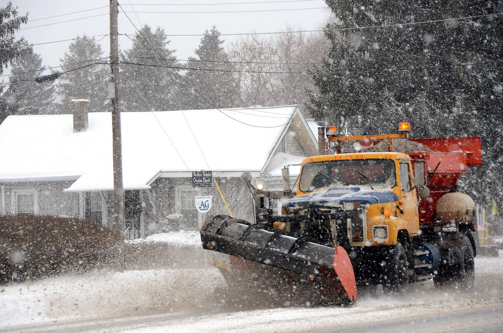 Description of . A snowplow travels along State Road in North Adams during the height of the snowstorm on Wednesday, Feb. 5, 2014. Gillian Jones/Berkshire Eagle Staff