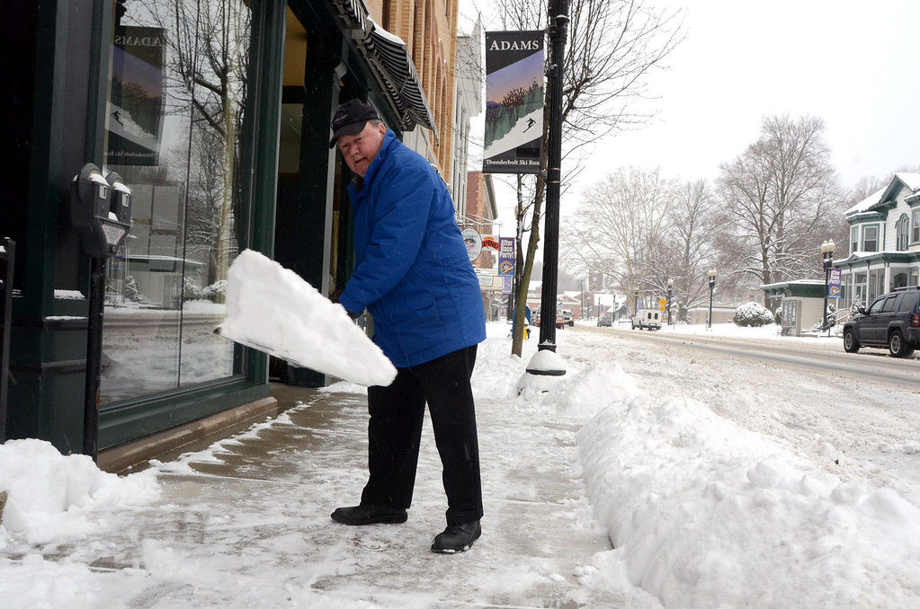 Description of . Bernie Pinsonnault shovels the sidewalk in front of Smith Bros McAndrews Insurance at 45 Park Street in Adams on Wednesday