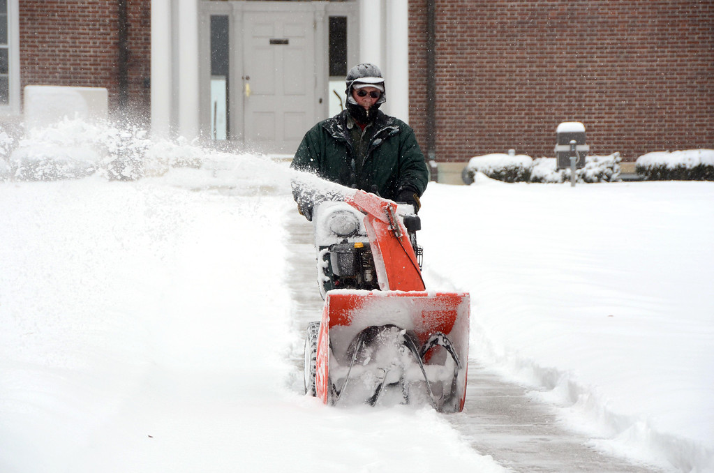 Description of . Gary Green snowblows the sidewalk in front of Town Hall on Park Street in Adams on Wednesday, Feb. 5, 2014. Many munipical offices were closed due to the storm. Gillian Jones/Berkshire Eagle Staff