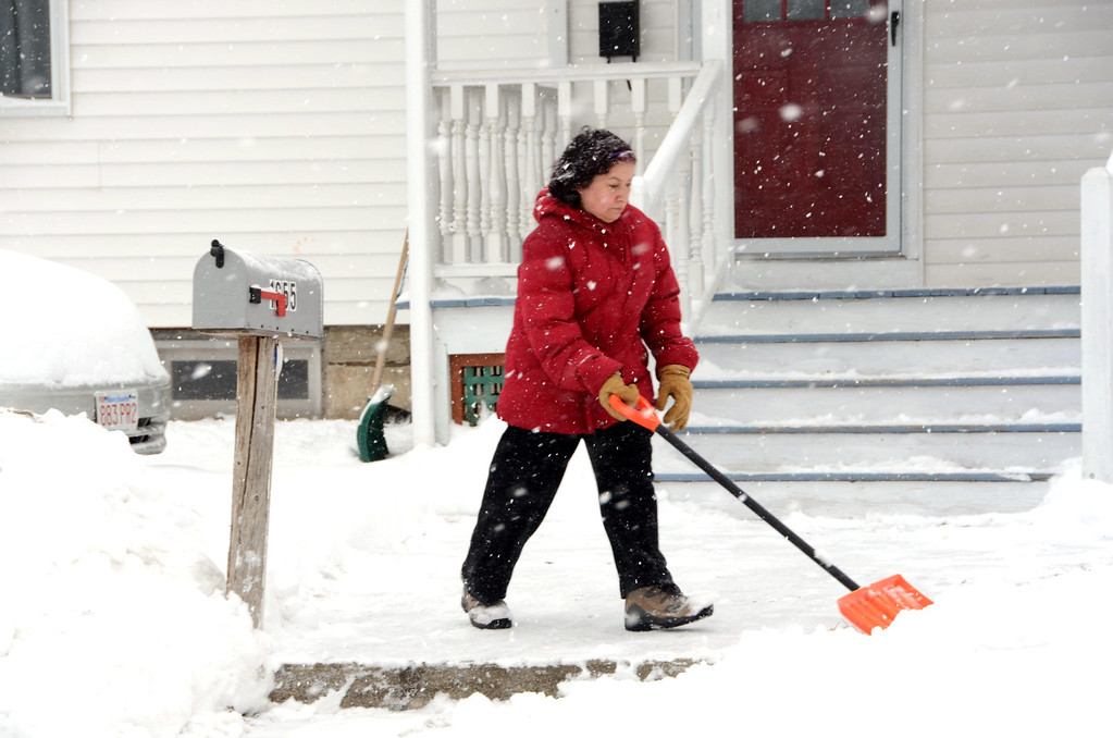 Description of . Maria Oriva shovels the snow from the front yard of her daughter's Massachusetts Avenue home in North Adams on Wednesday, Feb. 5, 2014. Gillian Jones/Berkshire Eagle Staff