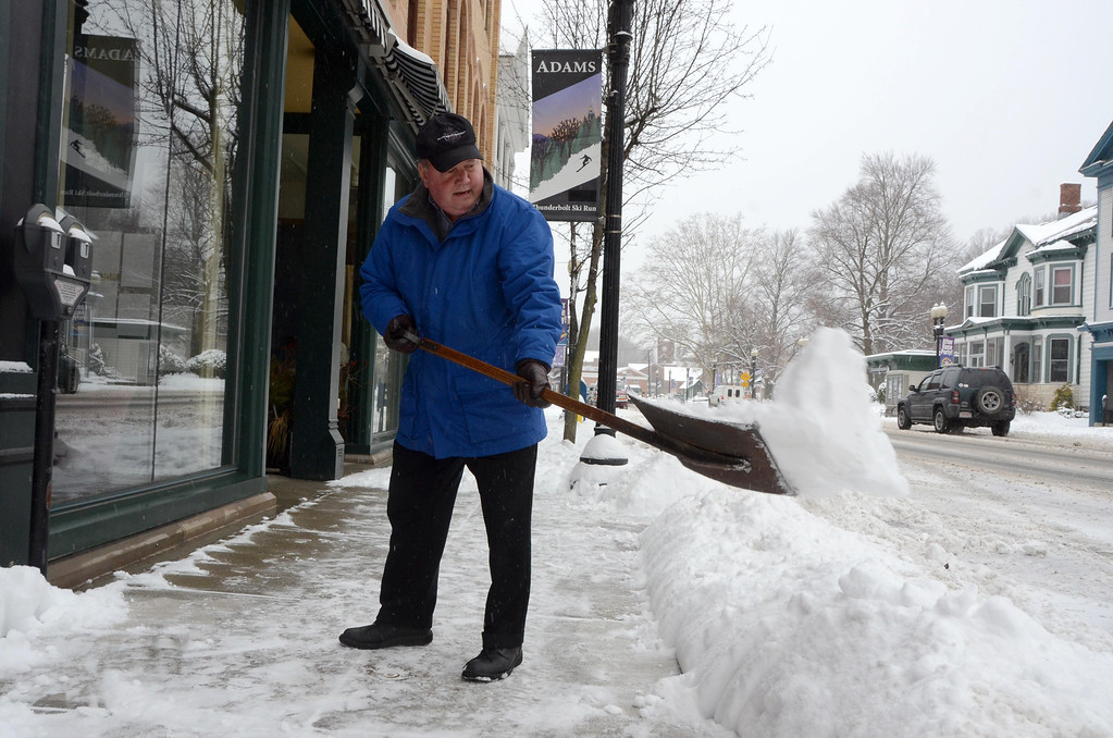 Description of . Bernie Pinsonnault shovels the sidewalk in front of Smith Bros McAndrews Insurance at 45 Park Street in Adams on Wednesday, Feb. 5, 2014. Gillian Jones/Berkshire Eagle Staff