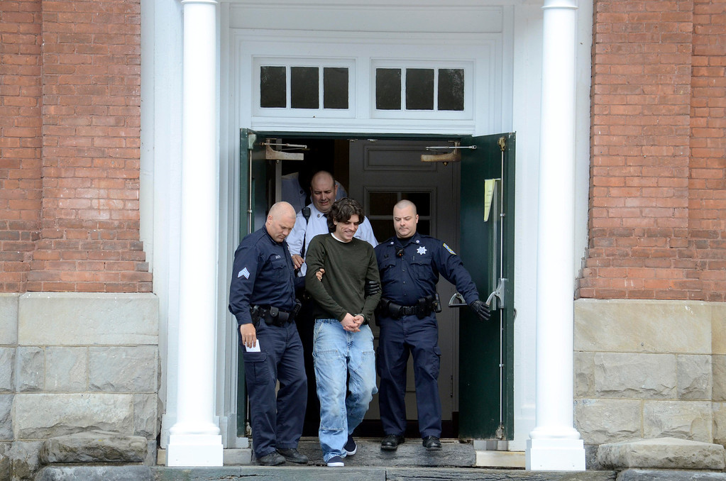 Description of . Christopher Blair is led out of  South Berkshire District Court (Great Barrington) after his arraignement for the robbery of the Lee Bank branch in Stockbridge, Thursday March 20, 2014.  Ben Garver / Berkshire Eagle Staff / photos.berkshireeagle.com