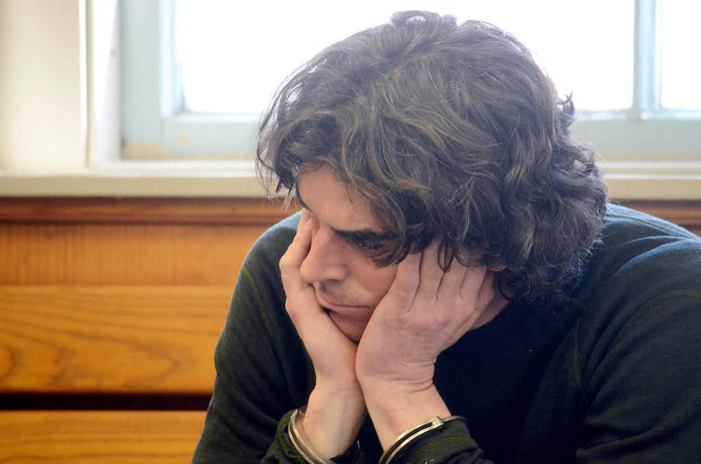 Description of . Christopher Blair sits in South Berkshire District Court (Great Barrington) for his arraignement for the robbery of the Lee Bank branch in Stockbridge, Thursday March 20, 2014.  Ben Garver / Berkshire Eagle Staff / photos.berkshireeagle.com