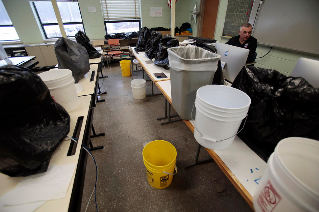 Description of . Half of a computer room has been inundated with leaking rain water at Taconic High School in Pittsfield. Thursday, March 20, 2014. Stephanie Zollshan / Berkshire Eagle Staff / photos.berkshireeagle.com