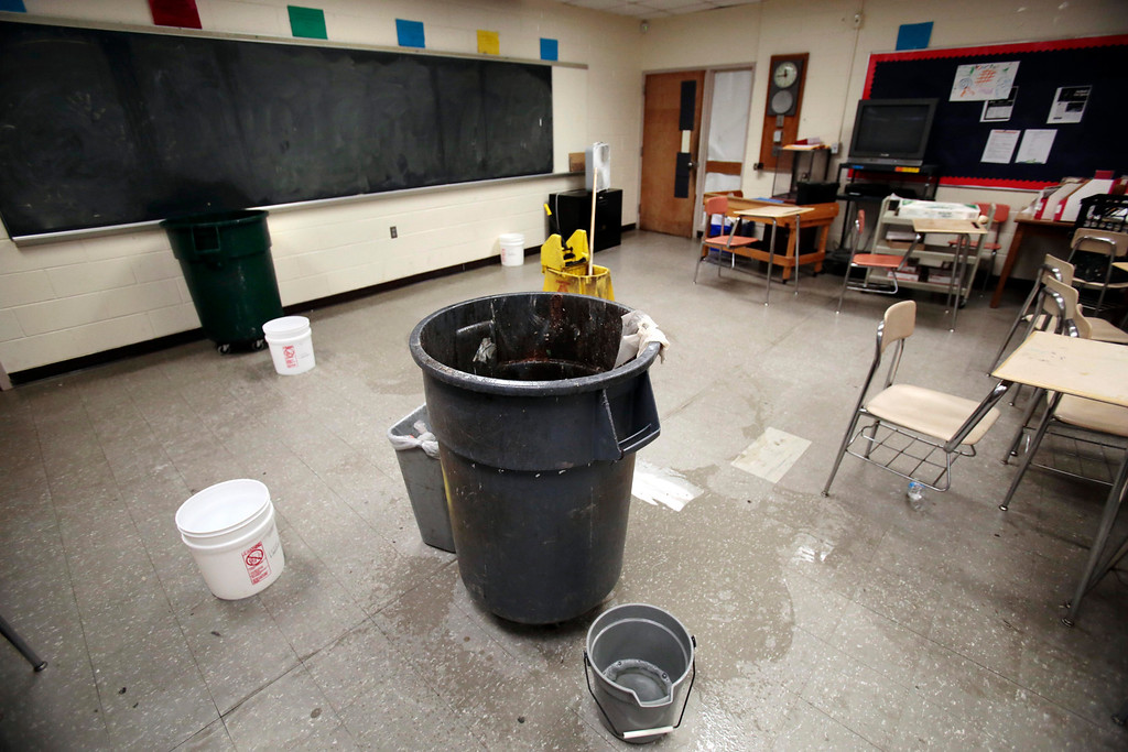 Description of . After running out of buckets, the staff has resorted to using garbage cans to catch leaking rainwater in the classrooms at Taconic High School in Pittsfield. Thursday, March 20, 2014. Stephanie Zollshan / Berkshire Eagle Staff / photos.berkshireeagle.com