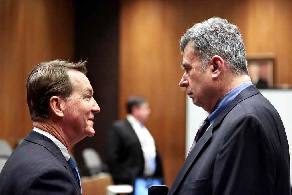 Description of . Berkshire District Attorney David Capeless, left, talks with defense attorney Alan Black between court sessions during the first day of the triple murder trial for Adam Lee Hall at the Springfield Courthouse. Monday, January 13, 2014. (AP Photo/Stephanie Zollshan, The Berkshire Eagle)