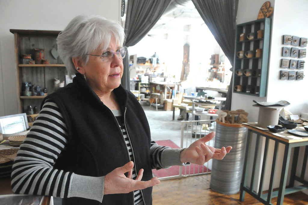 Description of . Gail Sellers talks about the ceramics studio she shares with her husband, Phil Sellers, in the Eclipse Mill in North Adams. Their living space is attached to both their pottery studio and store, River Hill Pottery. Monday, March 3, 2014 (Scott Stafford/Berkshire Eagle Staff)