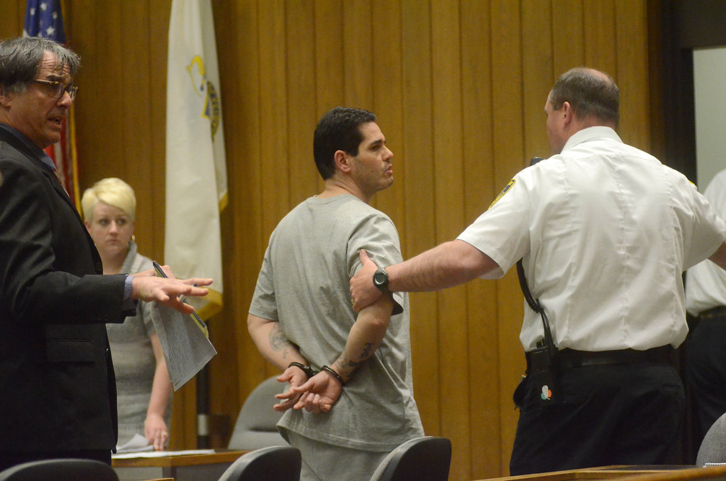 Description of . David Chalue is taken away after being sentenced to three consecutive life sentences on Monday, May 19, 2014, in Hampden Superior Court in Springfield. Gillian Jones / Berkshire Eagle Staff / photos.berkshireeagle.com