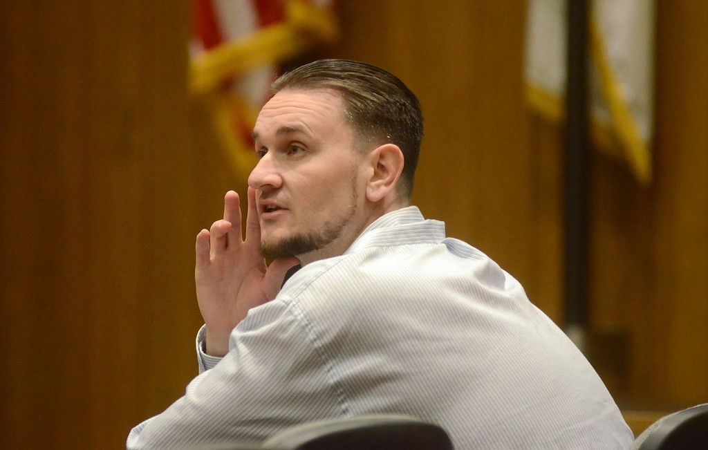 Description of . Adam Hall confers with his lawyers Alan J. Black and Jeanne A. Liddy during his trial in Springfield on Wednesday, January, 22, 2014. Gillian Jones/Berkshire Eagle Staff