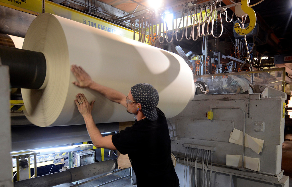 Description of . Ryan Isherwood prepares a roll of decorative paper at Onyx Specialty Papers in Lee, Friday Feb. 21, 2013.  Photo by Ben Garver / Berkshire Eagle Staff