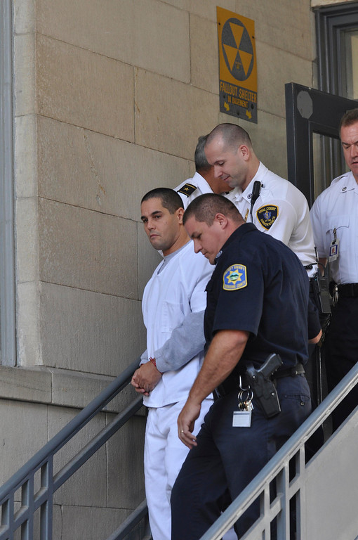 Description of . David T Chalue exits Berkshire Superior Court  under increased security after being arraigned on multiple charges, including murder, Wed Oct 12, 2011 (GARVER)