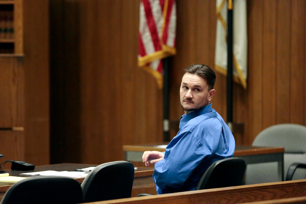 Description of . Adam Lee Hall waits for court to be back in session during the first day of his triple murder trial at the Springfield Courthouse. Monday, January 13, 2014. (AP Photo/Stephanie Zollshan, The Berkshire Eagle)