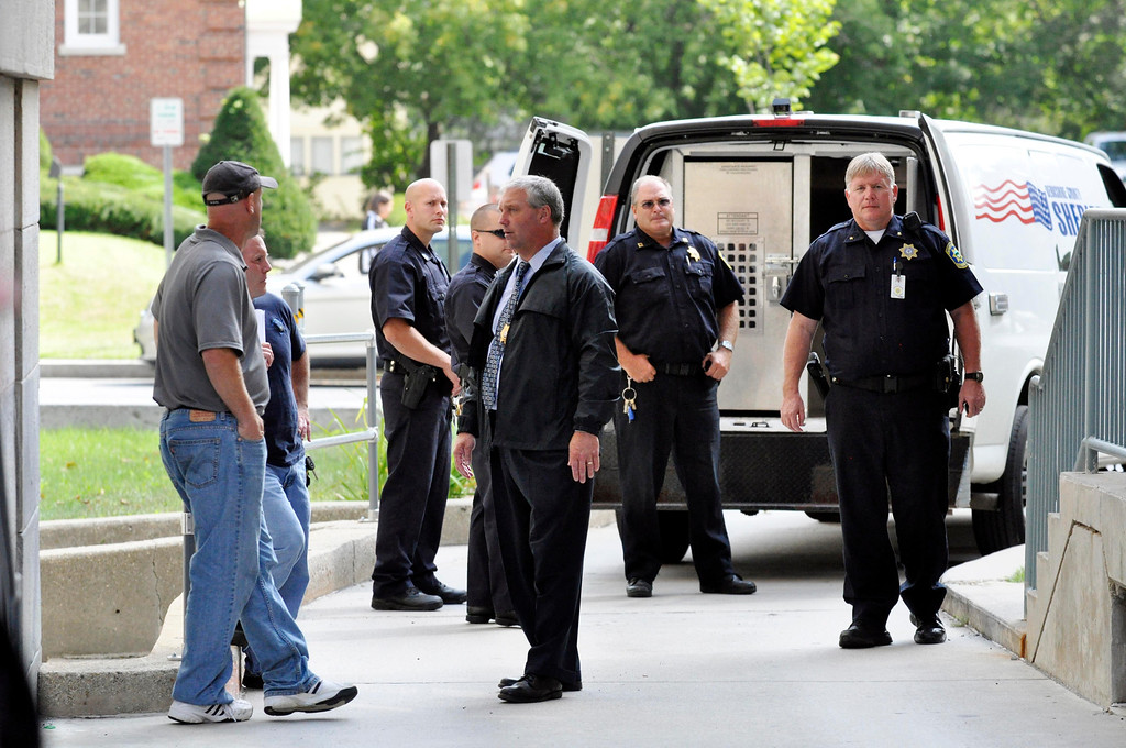 Description of . Security at District court in Pittsfield included at least 20 officers from several law enforcement agencies while Adam Lee Hall was escorted into court for  arraignment on murder charges.  Mon Sept 12, 2011 (GARVER)