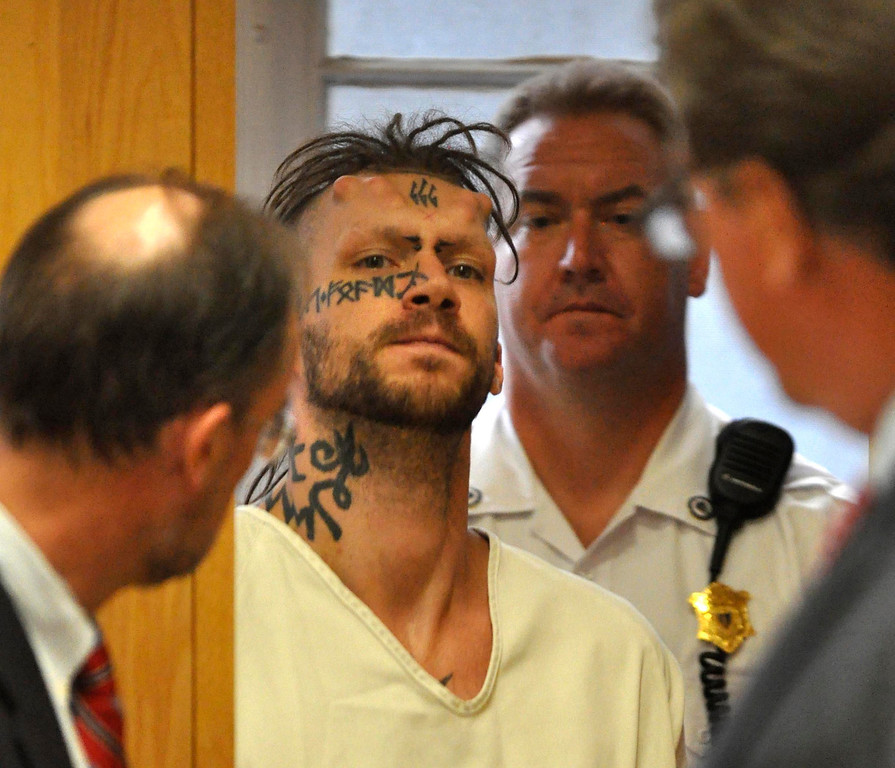 Description of . Caius Veiovis, 31, is arraigned in Berkshire District Court on charges of murder and kidnapping of three Pittsfield, Ma men.  CHalue was charged with Adam Lee Hall and David Chalue after the bodies of David Glasser, Edward Frampton and Robert Chadwell were discovered over the weekend.  Pittsfield, Monday September 12, 2011 (Ap Photo by Ben Garver, The Berkshire Eagle)