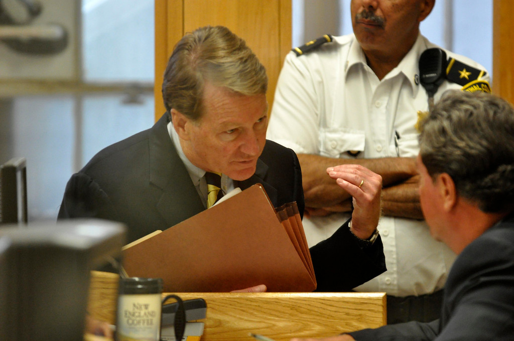 Description of . DIstrict Attorney David F. Capeless Confers with speaks with a David Kearns before the arraignment of  Adam Lee Hall, David Chalue and Cais Veiovis (Roy Gutfinski) on triple murder charges, Mon Sept 12, 2011 (GARVER)