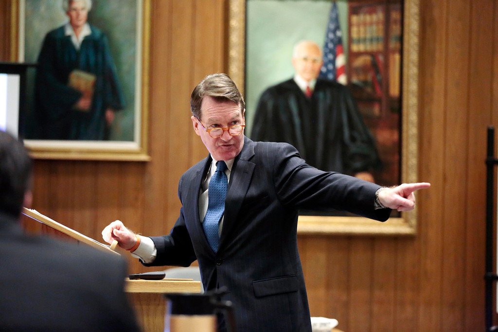 Description of . Berkshire District Attorney David Capeless points to the defendent in his opening statement to the jury during the first day of the triple murder trial for Adam Lee Hall at the Springfield Courthouse. Monday, January 13, 2014. (AP Photo/Stephanie Zollshan, The Berkshire Eagle)