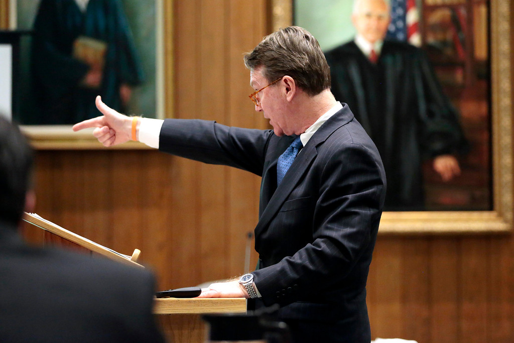 Description of . Berkshire District Attorney David Capeless describes how the defendent allegedly shot his victims in his opening statement to the jury during the first day of the triple murder trial for Adam Lee Hall at the Springfield Courthouse. Monday, January 13, 2014. (AP Photo/Stephanie Zollshan, The Berkshire Eagle)