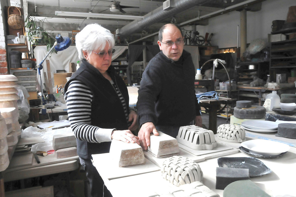 Description of . Phil and Gail Sellers in their ceramics studio in the Eclipse Mill in North Adams. Their living space is attached to both their pottery studio and store, River Hill Pottery. Monday, March 3, 2014 (Scott Stafford/Berkshire Eagle Staff)